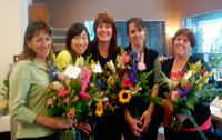 LSI San Diego teachers receiving flowers on Annual Appreciation Day